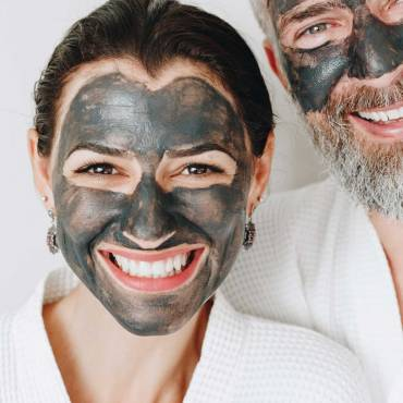 happy-couple-wearing-a-charcoal-mask-AXYBWQ9-scaled.jpg