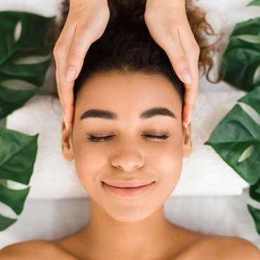 head-massage-afro-girl-getting-spa-treatment-BXBUA4N.jpg