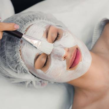 portrait-of-young-woman-while-facial-cosmetic-PGU9ZNZ.jpg